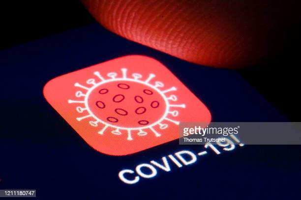 The logo of tracking app COVID19 is shown on the display of a smartphone on April 22 2020 in Berlin Germany