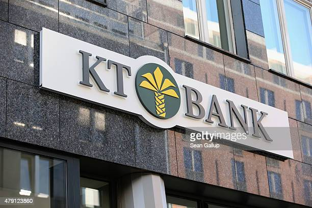 The logo of TurkishKuwaiti Islamic KT Bank hangs outside a branch on the branch's opening day on July 1 2015 in Berlin Germany KT Bank is opening...