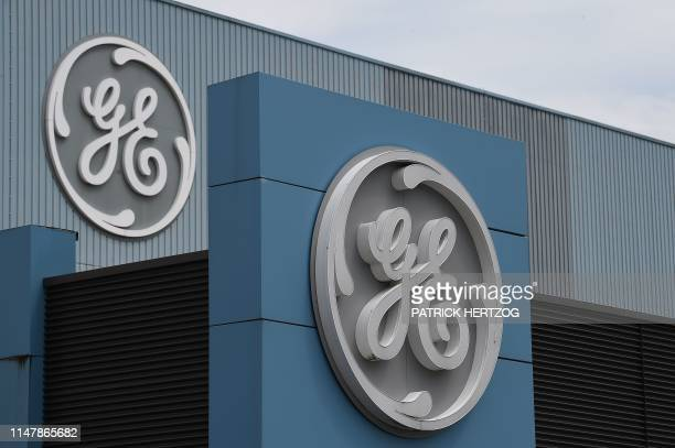 The logo of US giant General Electric is pictured as French Economy and Finance Minister Bruno Le Maire takes part to a meeting with managers and...