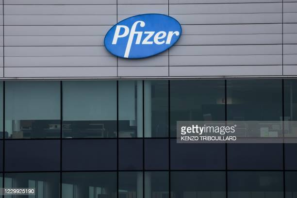 The logo of US multinational pharmaceutical company Pfizer, is pictured at a factory in Puurs, where Covid-19 vaccines are being produced for...
