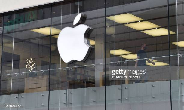 The logo of US tech giant Apple can be seen on an Apple store in Munich, southern Germany. - Apple said it planned to invest more than one billion...