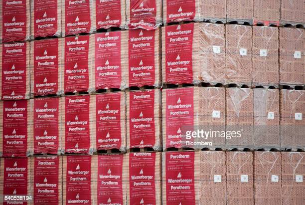 The logo of Wienerberger AG sits on the packaging of Porotherm insulated bricks ready for shipment at the Wienerberger AG brickmaking plant in...