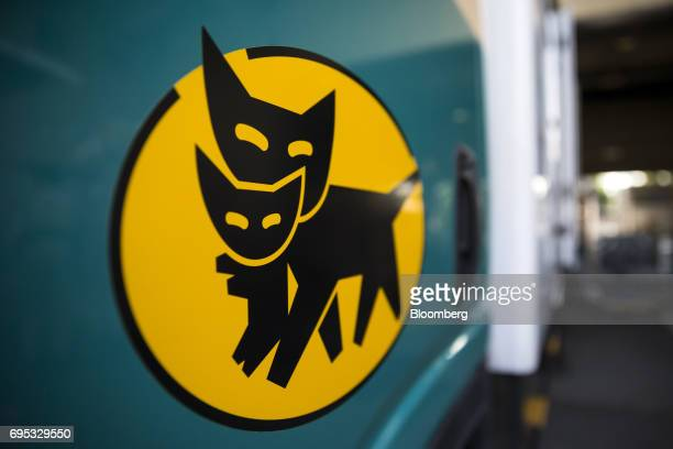 The logo of Yamato Transport Co is displayed on a delivery truck parked at a Yamato branch in Musashimurayama Tokyo Japan on Tuesday May 30 2017 In...
