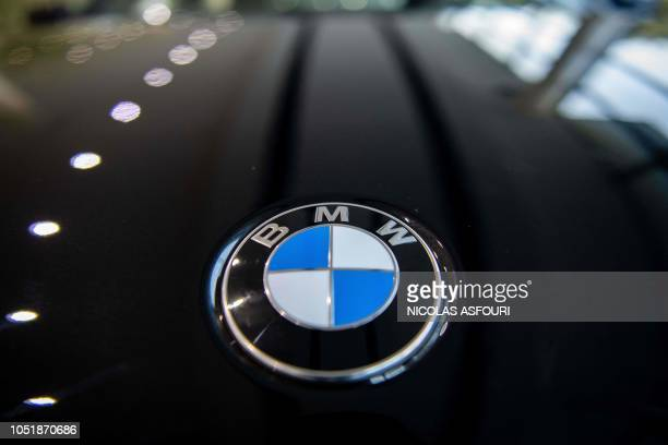 The logo on a BMW car is seen at the German automaker's dealership in Beijing on October 11 2018 German luxury carmaker BMW announced on October 11 a...