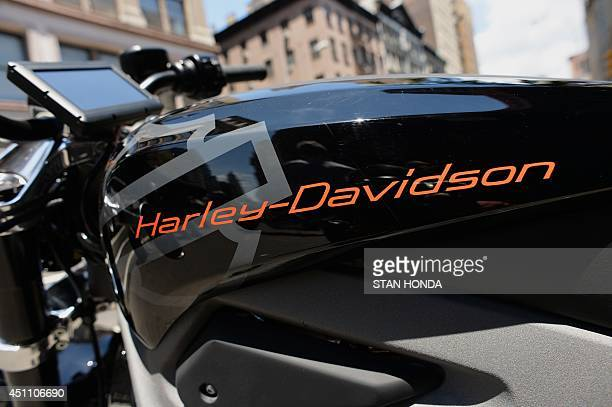 The logo on a HarleyDavidson Project LiveWire the company's first electric motorcycle during a preview June 23 2014 outside a HarleyDavidson dealer...