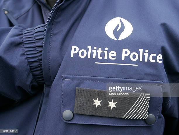 The logo on a police uniform is written in both French and Flemish on December 17 2007 in Brussels Belgium French speaking Walloons are resisting...