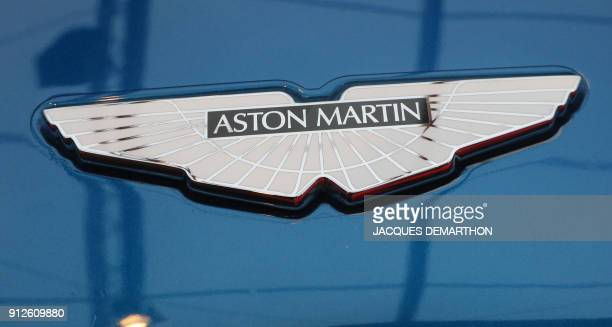 The logo on an Aston Martin Vanquish S is displayed at The International Automobile Festival in Paris on January 31 2018 / AFP PHOTO / JACQUES...