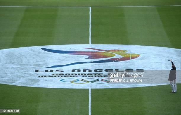 The logo on center of pitch is photographed as journalists visit the Rose Bowl as part of a tour of Olympic venues as officials attend the IOC...