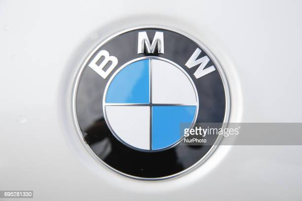 The logo on the hood of a hybrid BMW car is seen in Bydgoszcz Poland on 10 June 2017