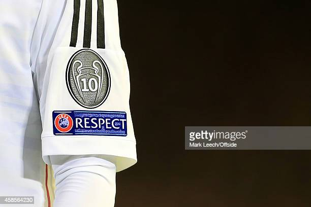 The logo on the Real Madrid sleeve denotes their 10 European Cup triumphs seen during the UEFA Champions League Group B match between Liverpool and...