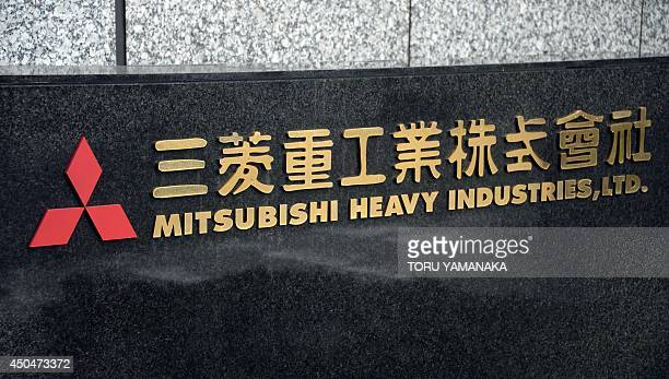 The logo outside the headquarters of Japan corporation Mitsubishi Heavy Industries is pictured in Tokyo on June 12, 2014. Mitsubishi Heavy Industries...