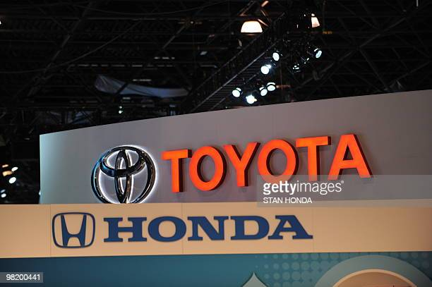 The logos for Toyota and Honda are seen at the New York International Auto Show on March 31 2010 in New York AFP PHOTO/Stan HONDA