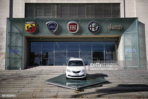 The logos of automobile companies Abarth Lancia Fiat Alfa Romeo and Jeep are pictured at the entrance to the Fiat Chrysler Automobiles at the Fiat...