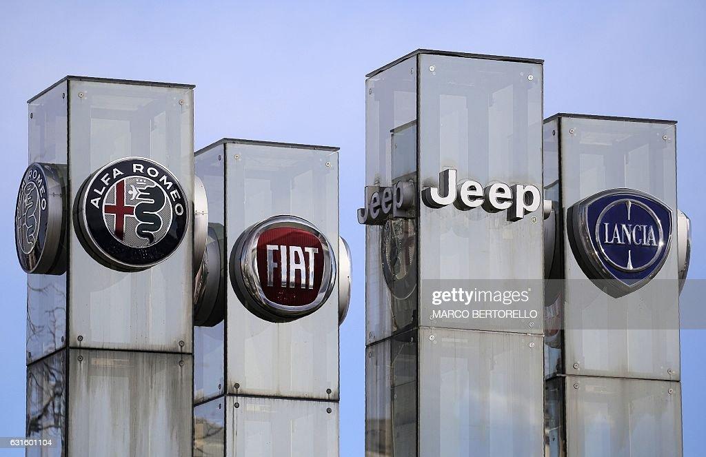 The logos of automobile companies (LtoR) Alfa Romeo, Fiat, Jeep and on dodge cars, nash cars, bmw cars, porsche cars, oldsmobile cars, cadillac cars, subaru cars, lincoln cars, hyundai cars, pontiac cars, plymouth cars, buick cars, gmc cars, chevy cars, imperial cars, volkswagen cars, ram cars, desoto cars, kia cars, jaguar cars,