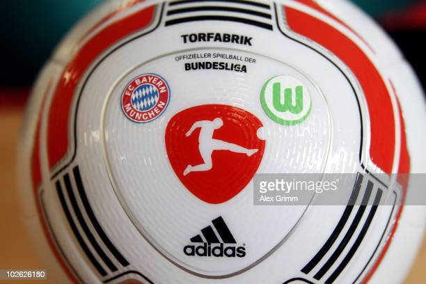 The logos of Bayern Muenchen and VfL Wolfsburg who will play the opening match of the 2010/2011 Bundesliga season are seen on the new 'Torfabrik'...