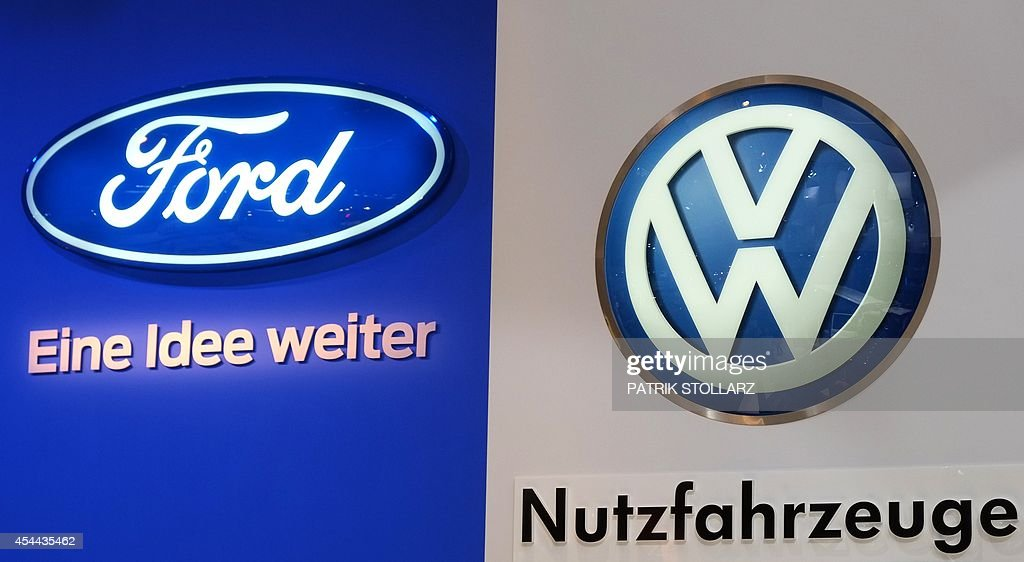 The Logos Of Car Makers Ford L And Volkswagen Vw R Are Seen At