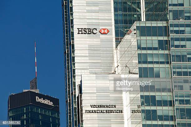 The logos of Deloitte LLC HSBC Bank Polska SA center and Volkswagen Financial Services AG sit on the exterior of office buildings in Warsaw Poland on...