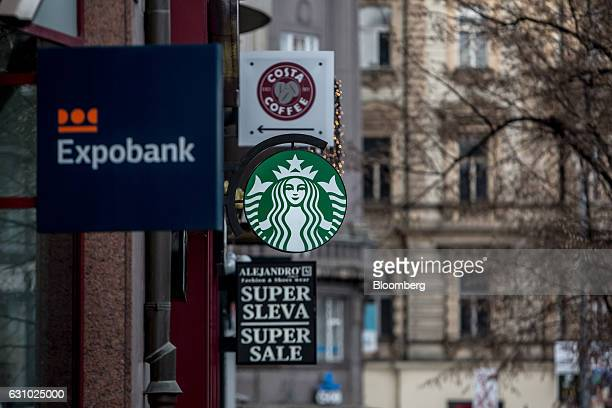 The logos of Expobank CZ AS left Starbucks Corp center and Costa Coffee Ltd sit outside stores in central Prague Czech Republic on Thursday Jan 4...