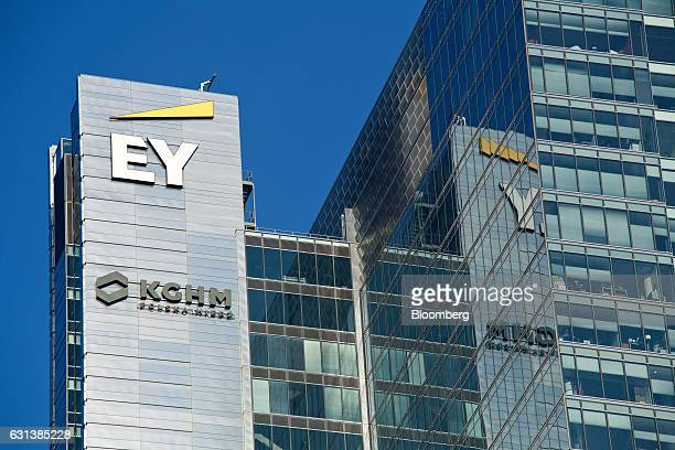 The logos of EY and KGHM Polska Miedz SA sit on the side of an office block in central Warsaw Poland on Monday Jan 9 2017 Investors in Poland are...