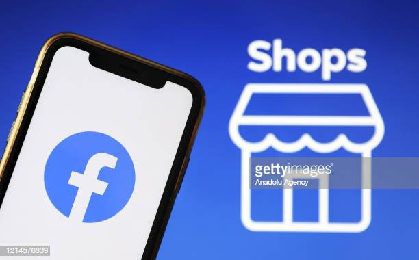 The logos of Facebook and Facebook Shops are seen on a smartphone and laptop screen in Ankara, Turkey on May 21, 2020. Hakan Nural / Anadolu Agency