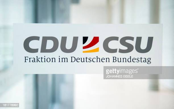 The logos of Germany's conservative CDU/CSU parties are seen at the union's parliamentary group rooms at the Bundestag in Berlin on September 25 2013...