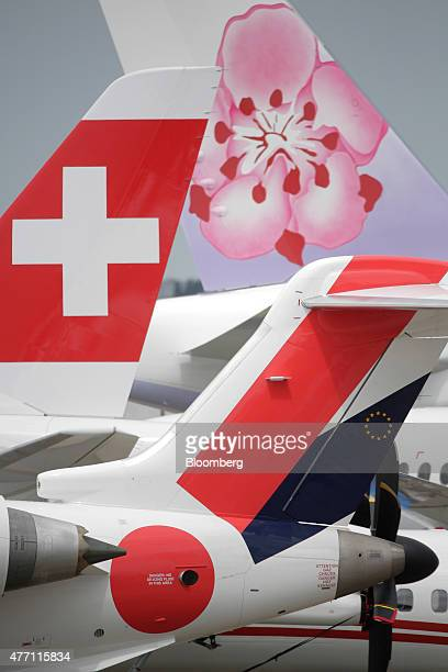 The logos of Swissair AG left and China Airlines Ltd top sit on the tail fins of aircraft on static display during preparations for the 51st...