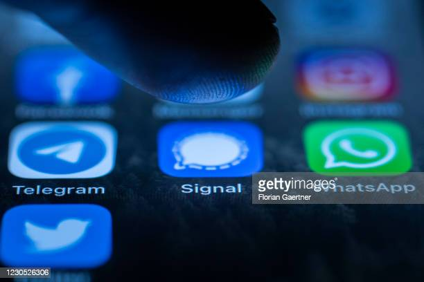 The logos of the messenger apps Signal, Telegram and WhatsApp are pictured on the display of an iphone on January 10, 2021 in Berlin, Germany.