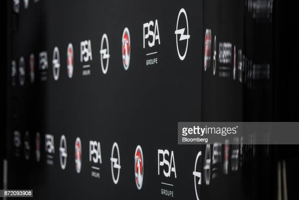 The logos of the PSA Group brands including Adam Opel AG and Vauxhall sit on display following a news conference at the Opel factory in Ruesselsheim...