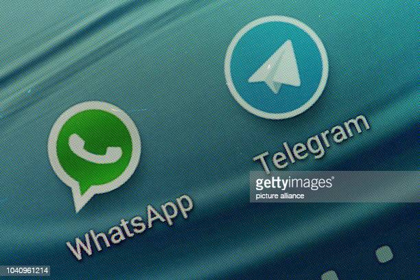 The logos of the short message services Telegram and WhatsApp are displayed on the screen of a smartphone in Straubing, Germany, 25 February 2014....