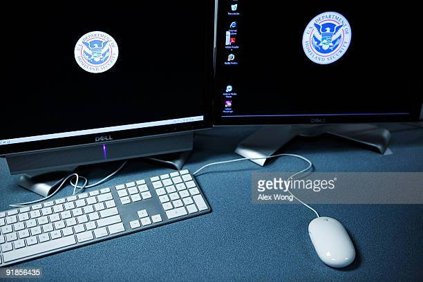The logos of the US Department of Homeland Security are seen on computer terminals in a training room of the Cyber Crimes Center of the US...