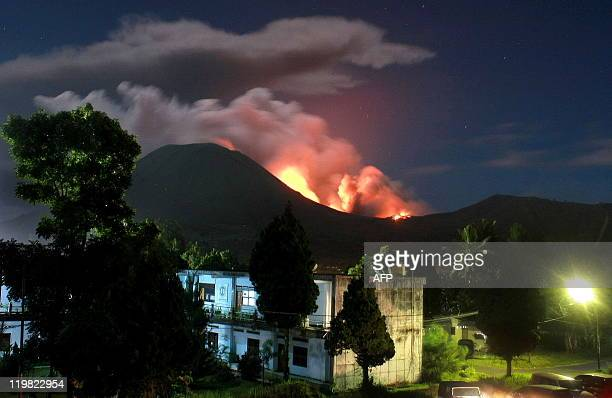 The Lokon volcano erupts near Tomohon on July 15, 2011. The Indonesian volcano erupted late July 14, spewing rocks, lava and ash hundreds of metres...