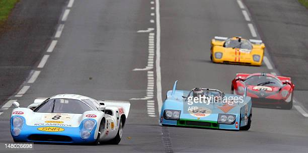 The Lola T70 MK III B driven by Greek Leo Voyazides competes in the lead of the race ahead of the Porsche 908 driven by German Roald Goethe during...