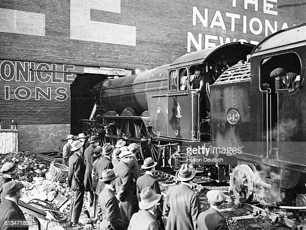 The London and North Eastern Railway Flying Scotsman locomotive leaves the Palace of Engineering at the close of 1924 British Empire Exhibition...