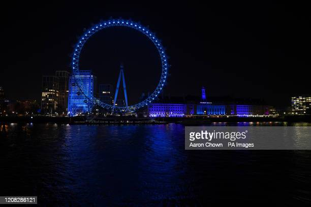 The London Eye and County Hall in London are lit up in blue in a gesture of thanks to the hardworking NHS staff who are trying to battle coronavirus....