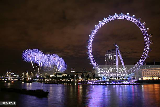 The London Eye at night with fireworks