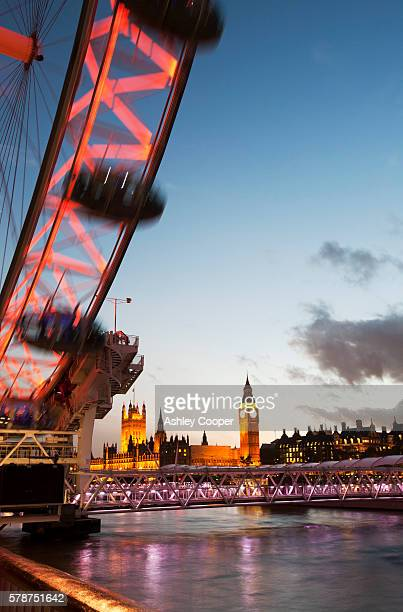 The London Eye is a massive 135 m or 443 foot tall ferris wheel, which is the most popular paid tourist attraction in the UK with around 3.5 million people per year. It sits on the South Bank just downstream from the houses of Parliament
