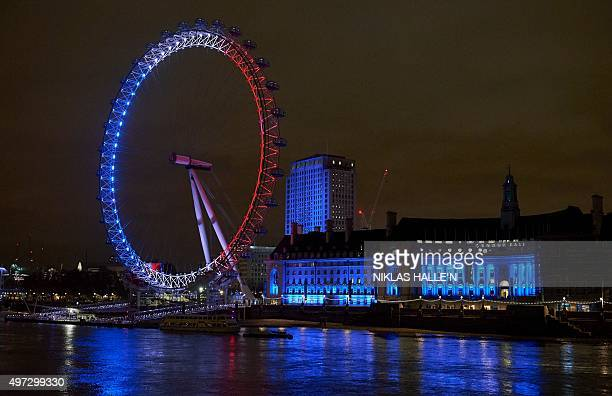 The London Eye is illuminated in blue white and red lights resembling the colours of the French national flag in central London on November 15 as...