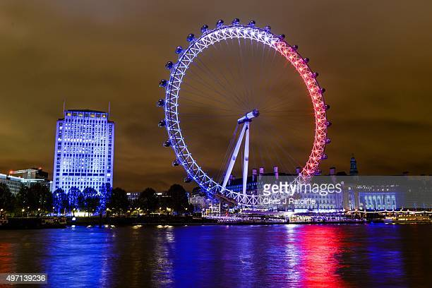 The London Eye is lit up in the colours of the French flag on November 14 2015 in London England Various landmarks around the globe have been lit in...