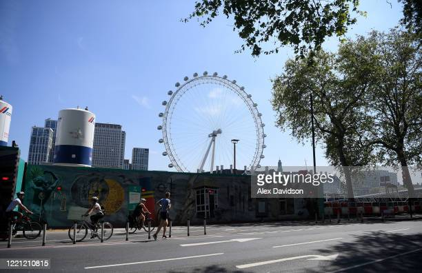 The London Eye is seen from the Embankment as runners go past on April 26 2020 in London England The 40th London Marathon was due to take place today...