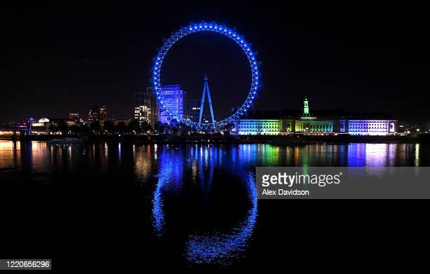 The London Eye is seen lit up blue in appreciation for the NHS on April 23 2020 in London United Kingdom Following the success of the Clap for Our...
