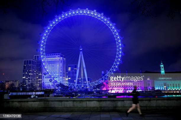 The London Eye tourist attraction is illuminated in blue light to celebrate to work of key workers, and those in Britain's NHS , in London on January...