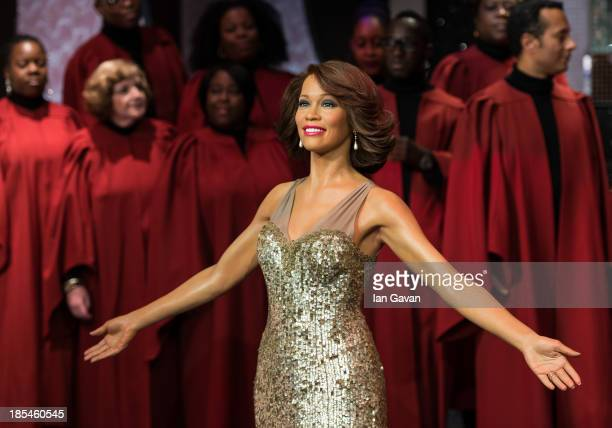 The London Gospel Factory Choir sing as a waxwork of the late singer Whitney Houston is unveiled at Madame Tussauds on October 21 2013 in London...