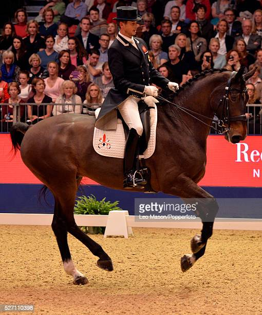 The London International Horse Show at Olympia UK FEI Reem Acra World Cup Dressage GP Freeestyle Carl Hester GBR riding Nip Tuck during their winning...