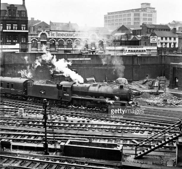 The London Midland and Scottish Railway Stanier Jubilee Class 460 steam locomotive Barfleur number 45685 departs from Birmingham New street heading...