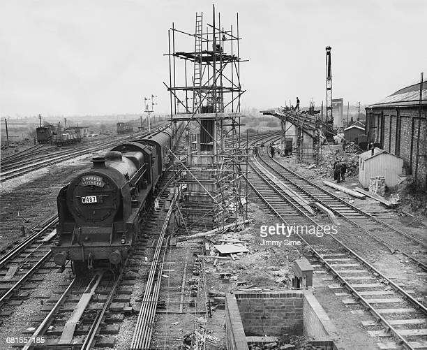 The London Midland and Scottish Railway steam locomotive Empress Voyager passes through the construction area for the new 1358 feet Bletchley rail...