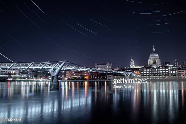 The London Millennium Footbridge is illuminated under the stars on a clear night on April 21 2020 in London England The clear skies created by the...