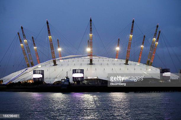 The London O2 arena owned by Anschutz Entertainment Group is seen illuminated at night in London UK on Tuesday Oct 2 2012 Billionaire Philip Anschutz...