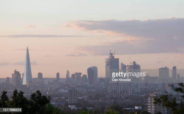 The London Skyline glows at sunset on August 16, 2018 in London, England.