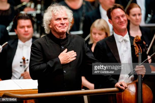 The London Symphony Orchestra's Music Director, Simon Rattle arrives to conduct the LSO, playing a programme by Helen Grime, Thomas Ades, Harrison...