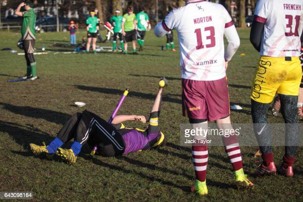 The London Unspeakables seeker holds up the snitch after catching it during a game at the Crumpet Cup quidditch tournament on Clapham Common on...